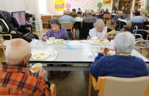 Elderly people eat lunch at a day care facility on Gogo Island in Matsuyama, Ehime Prefecture, Japan, on Friday, March 22, 2013. A combination of the world's highest life expectancy, the world's second-largest public debt and a below-replacement birthrate is straining the nation's pension system, prompting the government to curb payouts, raise contributions and delay the age of eligibility. Photographer: Yuriko Nakao/Bloomberg via Getty Images